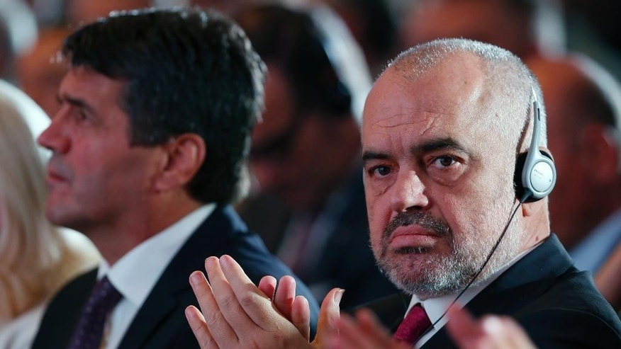 Albanian Prime Minister Edi Rama applauds after Serbian Prime Minister Aleksandar Vucic's speech, during the Business Forum Serbia - Albania, in the town of Nis, Serbia, Friday, Oct. 14, 2016. Serbian and Albanian politicians and businessmen are meeting in Nis as part of efforts to boost ties between Balkan rivals and help stabilise the troubled region.(AP Photo/Darko Vojinovic)