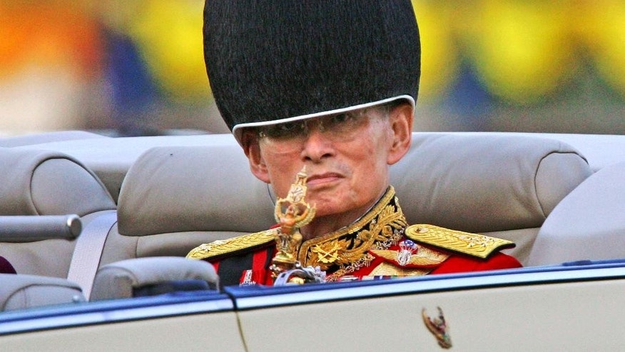 FILE - In this Saturday, Dec. 2, 2006, file photo, Thailand's King Bhumibol Adulyadej reviews the honor guard during celebrations of his 79th birthday in Bangkok. Thailand's Royal Palace said on Thursday, Oct. 13, 2016, that King Bhumibol, the world's longest-reigning monarch, has died at age 88. (AP Photo/Sakchai Lalit, File)
