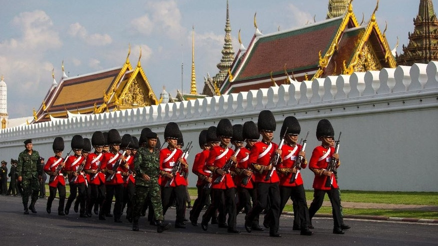 Thai Royal Guard march outside the Grand Palace Friday, Oct. 14, 2016 prior to a religious ceremony for the late King Bhumibol Adulyadej in Bangkok, Thailand. Bhumibol, the world's longest reigning monarch, died on Thursday at the age of 88. (AP Photo/Wason Wanichakorn)