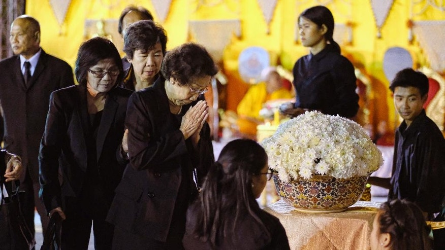 An elderly woman pays her respects during a memorial for Thailand's King Bhumibol Adulyadej, at Wat Thai Temple in the North Hollywood section of Los Angeles on Friday, Oct.14, 2016. The world's longest-reigning monarch died at 88, on Thursday. (AP Photo/Richard Vogel)