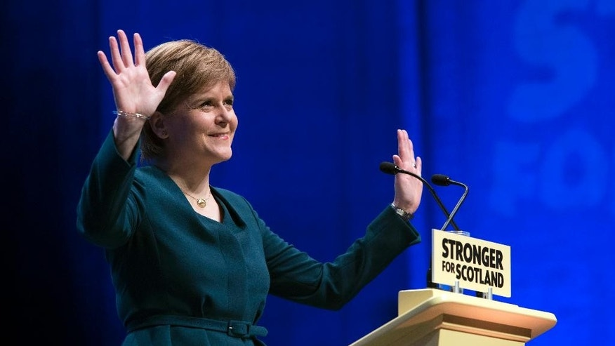 First Minister of Scotland and the leader of the Scottish National Party Nicola Sturgeon, at the start of the SNP's biggest-ever conference, in Glasgow, Scotland, Thursday, Oct. 13, 2016. Scotland's leader says she will publish a bill next week laying the groundwork for a new independence referendum — the first step toward a new vote on whether Scotland should leave the United Kingdom. (John Linton/PA via AP)