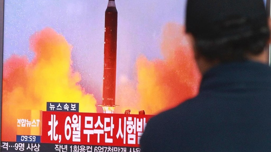 "A man watches a TV news program showing a file image of a missile launch conducted by North Korea, at the Seoul Railway Station in Seoul, South Korea, Sunday, Oct. 16, 2016. South Korea and the U.S. said Sunday that the latest missile launch by North Korea ended in a failure after the projectile exploded soon after liftoff. The letters read ""North attempted to fire a mid-range Musudan missile on June. (AP Photo/Ahn Young-joon)"