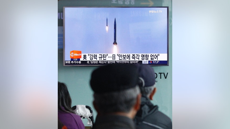 "People watch a TV news program showing a file footage of the missile launch conducted by North Korea, at Seoul Railway Station in Seoul, South Korea, Sunday, Oct. 16, 2016. South Korea and the U.S. said Sunday that the latest missile launch by North Korea ended in a failure after the projectile exploded soon after liftoff. The letters read ""The United States denounced North Korea's launch of a missile. (AP Photo/Ahn Young-joon)"