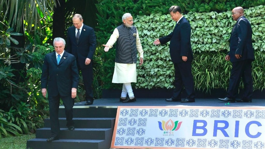 Leaders of BRICS countries, from left, Brazilian President Michel Temer, Russian President Vladimir Putin, Indian Prime Minister Narendra Modi, Chinese President Xi Jinping and South African President Jacob Zuma leave after a group photo at the start of the summit in Goa, India, Sunday, Oct. 16, 2016. Leaders of five of the world's fast-rising powers are meeting in the southwestern Indian state of Goa for their annual summit at a time when their ability to shape the global dialogue on international politics and finance is increasingly being questioned. Brazil, Russia, India, China and South Africa, or BRICS, face the tough task of asserting their growing influence as a power group even as they bridge their own trade rivalries to help grow their economies. (AP Photo/Anupam Nath)