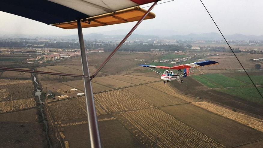 "An ultralight aircraft flies over farmland on Sunday, Oct. 16, 2016, in Pyongyang, North Korea. Until a few months ago, if you wanted a bird's eye view of North Korea's capital there was basically only one option: a 150-meter tall tower across the river from Kim Il Sung Square. Now, if you have the cash, you can climb into the backseat of an ultralight aircraft. With the support of North Korean leader Kim Jong Un, who has vowed to give North Koreans more modern and ""cultured"" ways to spend their leisure time, a Pyongyang flying club has started offering short flights over some of the capital's major sights. (AP Photo/Wong Maye-E)"