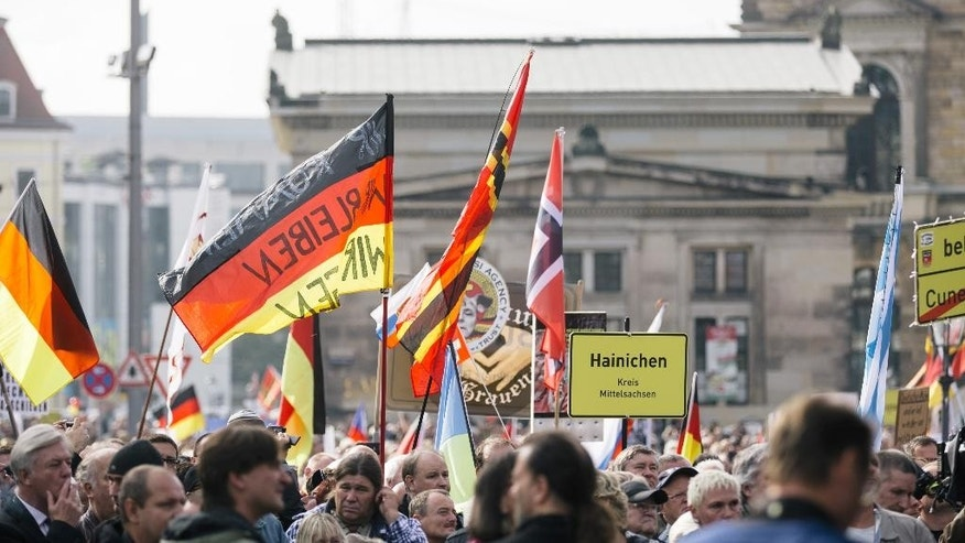 Several thousands of  right-wing Pegida supporters demonstrate on theatre square in Dresden, Germany, Sunday Oct. 16, 2016.  PEGIDA  stands for (Patriotic Europeans against the Islamisation of the West).  (Oliver Killig/dpa via AP)