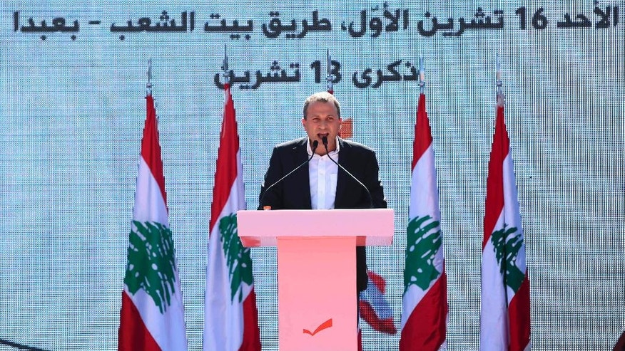"Head of the Free Patriotic Movement and Lebanese Foreign Minister Gibran Bassil speaks during a rally near the presidential palace in the Beirut suburb of Baabda, Lebanon, Sunday, Oct. 16, 2016. Christian leader Michel Aoun said during a speech that respecting Lebanon's equal power sharing system between Christians and Muslims will pave the way for building a proper state. Arabic on the picture reads ""Sunday, 16 October, People's road house, Baabda. Memory of 13 October.""(AP Photo/Hassan Ammar)"
