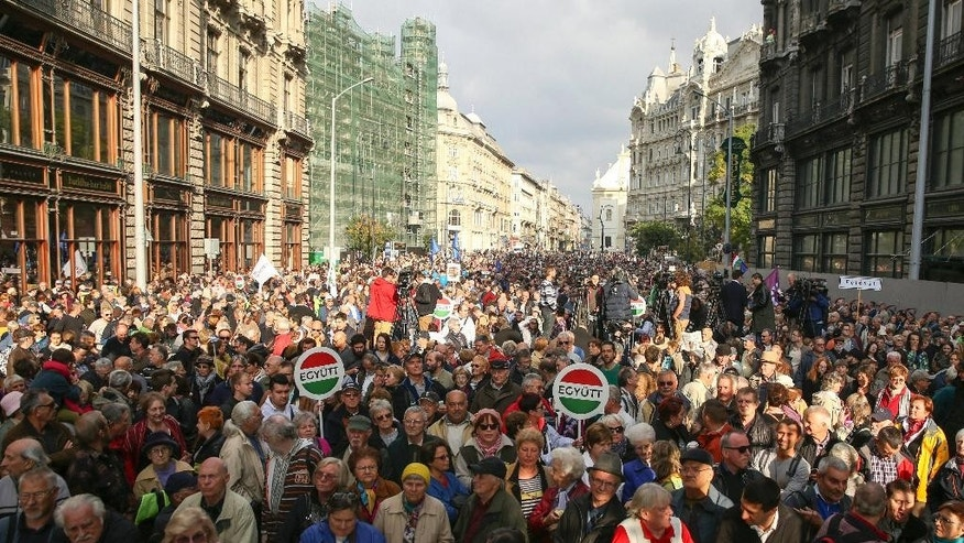 "Supporters of three opposition parties Dialogue for Hungary (PM), Together and  'Politic Can Be Different' attend a demonstration organized against corruption and to express solidarity with Hungarian political daily Nepszabadsag in downtown Budapest, Hungary, Sunday, Oct. 16, 2016. On Oct. 8, the publishing company Mediaworks suspended the publication of both the print and online editions of the Nepszabadsag due to the paper's accumulated over 5 billion forints (EUR 16.4m) in losses since 2007, until it comes up with a new business model. Placards say: ""Together"".   (Balazs Mohai/MTI via AP)"