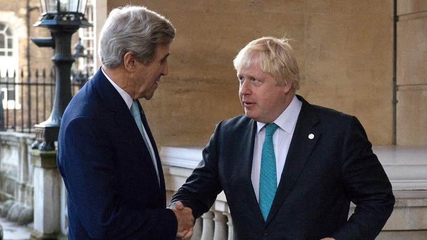 US Secretary of State John Kerry, left, is greeted by British Foreign Secretary Boris Johnson ahead of a meeting on the situation in Syria, at Lancaster House in London, Sunday Oct. 16, 2016.  Renewed international efforts to solve the conflict in Syria, heightened by the plight of people in the city of Aleppo, have made little progress but more talks are planned. ( JUSTIN TALLIS / Pool via AP)