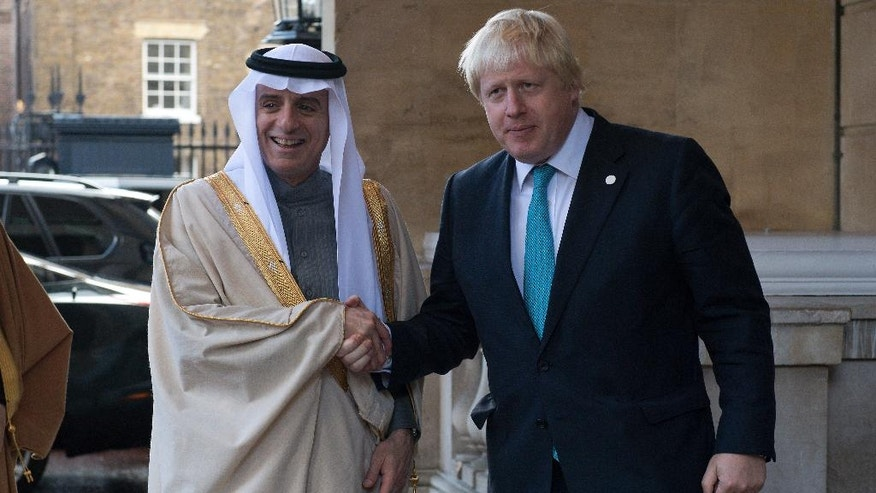 Saudi Arabia's Foreign Minister Adel al-Jubeir,  left, is greeted by British Foreign Secretary Boris Johnson ahead of a meeting on the situation in Syria, at Lancaster House in London, Sunday Oct. 16, 2016.  Renewed international efforts to solve the conflict in Syria, heightened by the plight of people in the city of Aleppo, have made little progress but more talks are planned. ( JUSTIN TALLIS / Pool via AP)