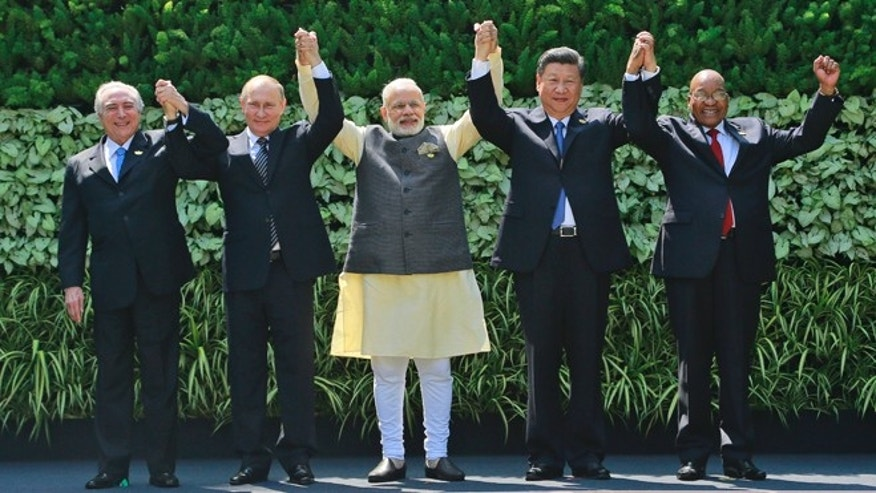 Brazilian President Michel Temer, Russian President Vladimir Putin, Indian Prime Minister Narendra Modi, Chinese President Xi Jinping, and South African President Jacob Zuma in Goa, India, Sunday, Oct. 16, 2016.