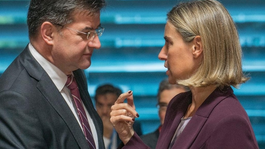 Slovakia's foreign minister Miroslav Lajcak, left, speaks with EU Council High Representative Federica Mogherini during a meeting of EU foreign ministers at the EU Council building in Luxembourg, Monday, Oct. 17, 2016. European Union foreign ministers debated Monday whether to extend sanctions against the Syrian regime as political efforts to secure a cease-fire and access for humanitarian aid falter. (AP Photo/Olivier Matthys)