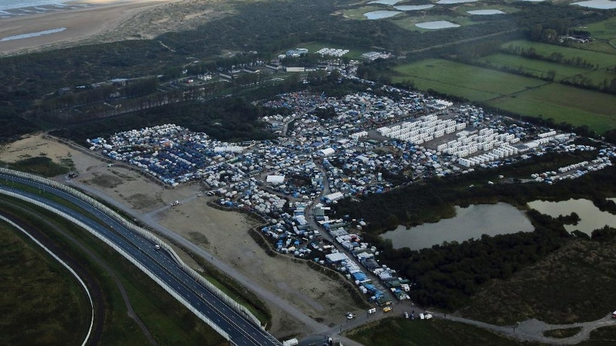 An aerial view of a makeshift migrant camp near Calais, France, Monday, Oct. 17, 2016. The government is gradually deporting migrants without right to asylum and relocating the rest to more than 160 centers around France. It is expected to close the camp in the coming weeks but no official dates have been announced. (AP Photo/Thibault Camus)
