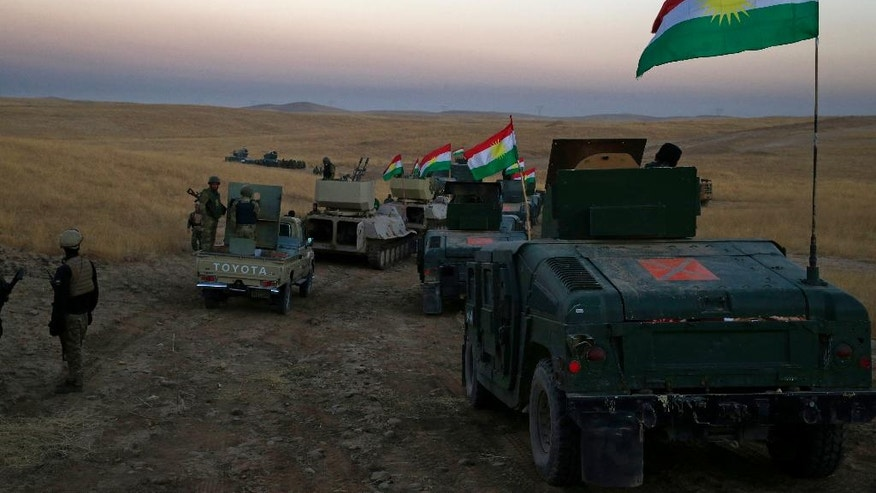 A Peshmerga convoy drives towards a frontline in Khazer, about 30 kilometers (19 miles) east of Mosul, Iraq, Monday, Oct. 17, 2016. The Iraqi military and the country's Kurdish forces say they launched operations to the south and east of militant-held Mosul early Monday morning. (AP Photo/Bram Janssen)