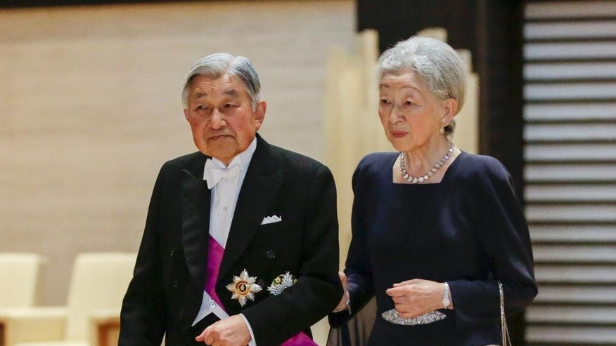 FILE - In Tuesday, Oct. 11, 2016 file photo, Japanese Emperor Akihito, left, and Empress Michiko arrive at the entrance hall to greet Belgian King Philippe and Queen Mathilde arriving for a banquet held by Akihito at the Imperial Palace in Tokyo. Experts on a government-commissioned panel were set to hold their first meeting Monday, Oct. 17, to study how to accommodate Akihito's apparent abdication wish, in a country where he is not supposed to say anything political. (Kimimasa Mayama/Pool Photo via AP, File)