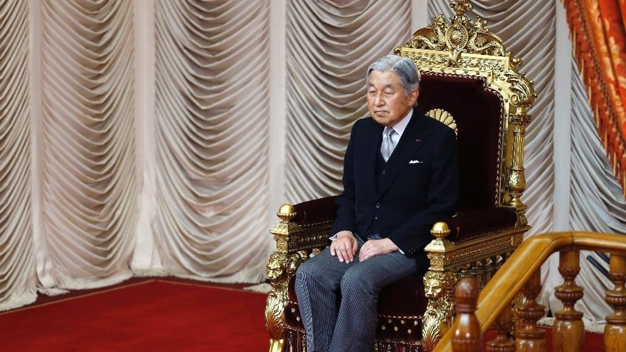 FILE - In this Sept. 26, 2016 file photo, Japan's Emperor Akihito is seated during the opening of a 66-day extraordinary Diet session at the upper house of parliament in Tokyo.  Experts on a government-commissioned panel were set to hold their first meeting Monday, Oct. 17, 2016,  to study how to accommodate Emperor Akihito's apparent abdication wish, in a country where he is not supposed to say anything political.  (AP Photo/Shizuo Kambayashi, File)