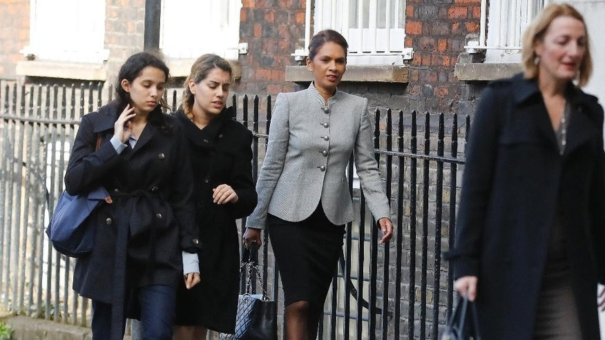 Gina Miller, centre, a founder of investment management group SCM Private arrives at the High Court on the second day of the lawsuit for the Brexit legal challenge, in London, Monday, Oct. 17, 2016. A judicial review action has been brought by British citizens who say the Government cannot trigger Article 50 of the Treaty of Lisbon - enabling the UK to leave the EU - without the prior authorization of Parliament.(AP Photo/Frank Augstein)