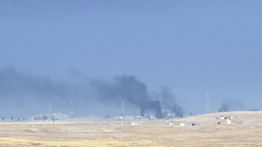 Smoke rises from Islamic state positions after an airstrike by coalition forces in Mosul, Iraq, Monday, Oct. 17, 2016. Iraqi government and Kurdish forces, backed by U.S.-led coalition air and ground support, launched coordinated military operations early on Monday as the long-awaited fight to wrest the northern city of Mosul from Islamic State fighters got underway.(AP Photo/Khalid Mohammed)