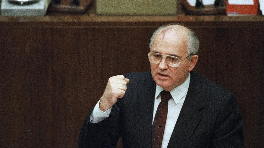 FILE - In this Jan. 14, 1991 file photo, Soviet President Mikhail Gorbachev says in Moscow that a local military commander ordered the use of force in the breakaway republic of Lithuania, where an assault by Soviet troops on Jan. 13, 1991 claimed 14 lives. On Monday, Oct. 17, 2016, a Lithuanian court has called on Gorbachev to testify in a mass trial related to the 1991 crackdown on the country's independence movement. (AP Photo/Boris Yurchenko, File)