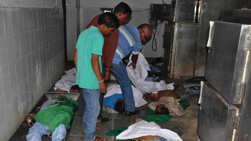 CORRECTS TO SAY THAT PHOTO WAS TAKEN AT A DIFFERENT HOSPITAL THAN THE SUM HOSPITAL - Bodies of victims of a fire at the private Sum Hospital are laid out for post-mortem at another hospital in Bhubaneswar, in the eastern Indian state of Orissa, Monday, Oct. 17, 2016. Ramesh Manjhi, a senior fire official, told the New Delhi Television news channel that the fire had been brought under control by late Monday night. More than 20 people died in the fire at Sum Hospital's intensive care unit. (AP Photo)