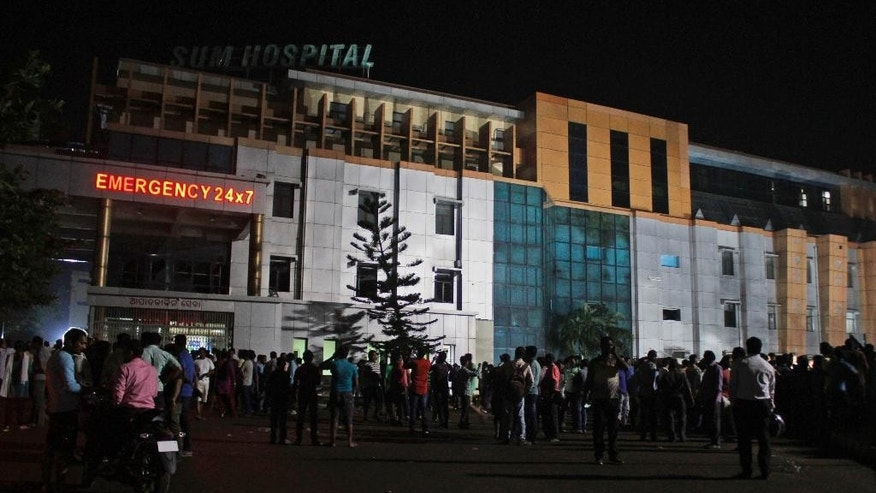 People gather outside the private Sum Hospital after a fire broke out in its intensive care unit, in Bhubaneswar, in the eastern Indian state of Orissa, Monday, Oct. 17, 2016. Ramesh Manjhi, a senior fire official, told the New Delhi Television news channel that the fire had been brought under control by late Monday night. More than 20 people died in the fire. (AP Photo)