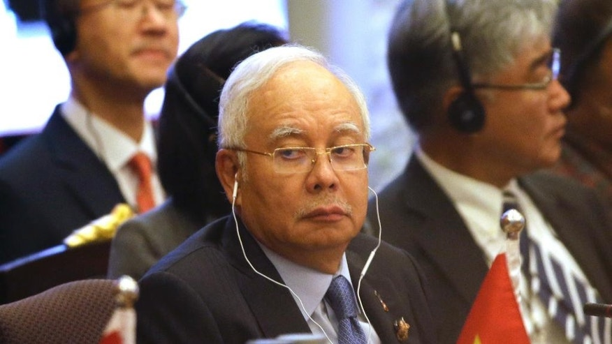 FILE - In this Oct. 10, 2016, file photo, Malaysian Prime Minister Najib Razak attends the opening ceremony of the 2nd Asia Cooperation Dialogue summit at Foreign Ministry in Bangkok, Thailand. Malaysia's prime minister said the country will not compromise on its South China Sea claims but wants them to be hashed out through dialogue and peaceful negotiations. (AP Photo/Sakchai Lalit, File)
