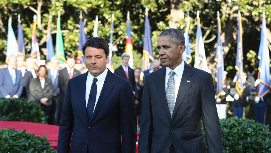 President Barack Obama walks with Italian Prime Minister Matteo Renzi, to review the troops during a state arrival ceremony on the South Lawn of the White House in Washington, Tuesday, Oct. 18, 2016. (AP Photo/Manuel Balce Ceneta)
