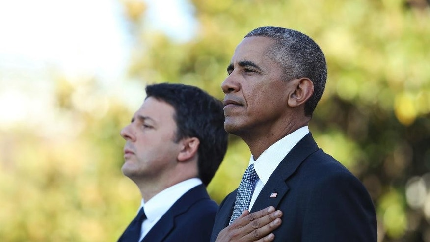 President Barack Obama and Italian Prime Minister Matteo Renzi stand at attention as the Star Spangled Banner is played during a state arrival ceremony on the South Lawn of the White House in Washington, Tuesday, Oct. 18, 2016. (AP Photo/Manuel Balce Ceneta)