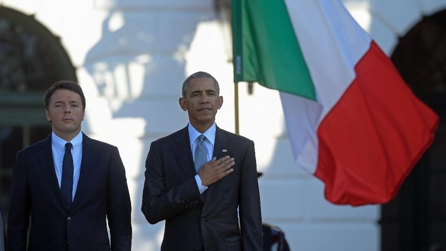 President Barack Obama and Italian Prime Minister Matteo Renzi listen to the National Anthem during a state arrival ceremony on the South Lawn of the White House in Washington, Tuesday, Oct. 18, 2016. (AP Photo/Susan Walsh)