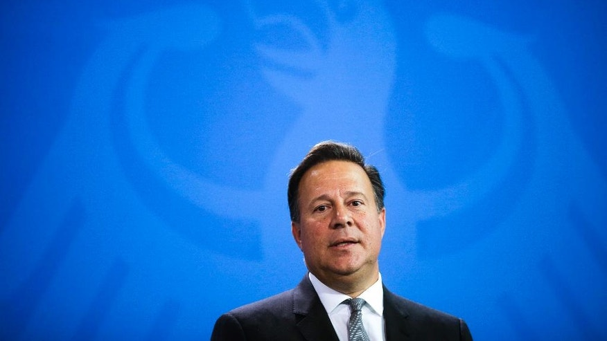 Panama's President Juan Carlos Varela attends a news conference with German Chancellor Angela Merkel after talks at the chancellery in Berlin, Tuesday, Oct. 18, 2016. (AP Photo/Markus Schreiber)