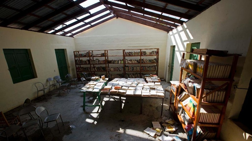 Books dry inside the library of a damaged public school after Hurricane Matthew hit in the village of Mersan, located in Camp-Perrin, a district of Les Cayes, Haiti, Monday, Oct. 17, 2016. Only a few schools opened despite the fact that Haiti's central government said classes would begin resuming across the storm-devastated southwest region on Tuesday. Local officials said it will be a long time before that happens. (AP Photo/Dieu Nalio Chery)