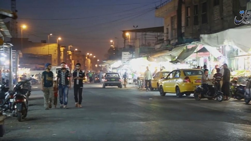 This image made from video posted online on Monday, Oct. 17, 2016 by Amaq News Agency of the Islamic State militant group shows a street scene in Mosul, Iraq. Residents who have endured more than two years of militant rule describe a city under siege, and say a new sense of terror has set in since Iraq announced the start of a long awaited operation to liberate its second largest city. (militant video, Amaq News Agency via AP)