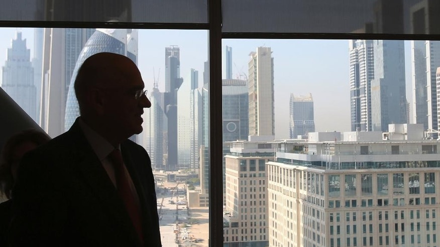 "Masood Ahmed, director of IMF Middle East and Central Asia Department, stands in front of the view of Dubai skyline from The Gate building before a press conference on the IMF Regional Economic Outlook Update in Dubai, United Arab Emirates, Wednesday, Oct. 19, 2016. Ahmed told The Associated Press that oil-producing Mideast countries ""still have some way to go"" in reforming government sector and cutting spending. ((AP Photo/Kamran Jebreili)"