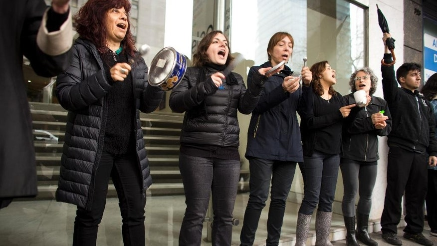 Women chant slogans as they participate in a one-hour strike outside their workplace to protest violence against women in Buenos Aires, Argentina, Wednesday, Oct. 19, 2016. Women across the country participated in protests in response to the shocking rape and killing of a teenage girl on Oct. 8 in Mar de Plata. (AP Photo/Victor R. Caivano)