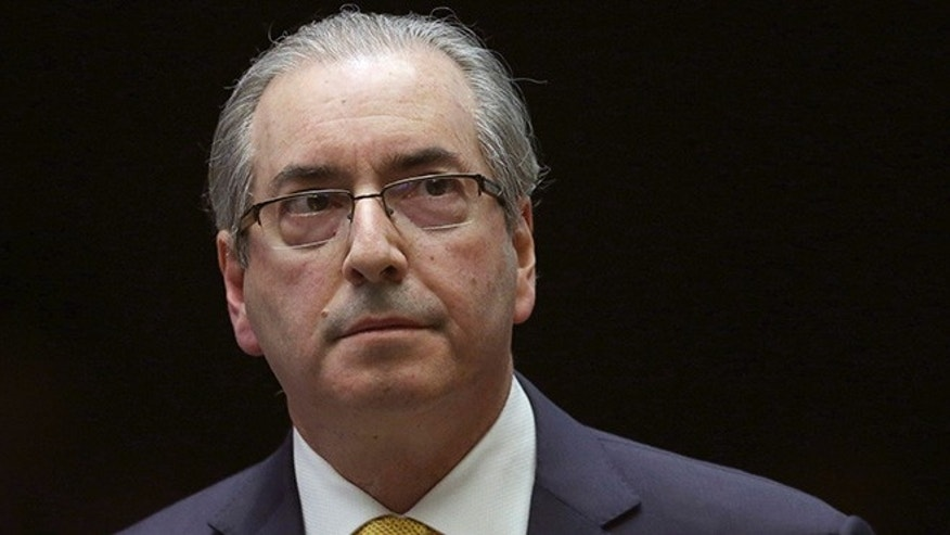 FILE - In this Sept. 12, 2016 file photo, Brazil's former President of the Chamber of Deputies Eduardo Cunha takes a break during the presentation of his defense in the Chamber of Deputies, in Brasilia, Brazil. The man who led efforts to impeach former President Dilma Rousseff was arrested on Wednesday, Oct. 19, 2016 in Brazilâs sprawling corruption probe at state-run oil giant Petrobras. The arrest made in the capital of Brasilia was confirmed by the office of Judge Sergio Moro, who chairs many investigations of the scandal. (AP Photo/Eraldo Peres, File)