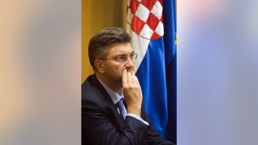 New Croatian Prime Minister, Andrej Plenkovic, listens to the proceedings during a parliament session in Zagreb, Croatia, Wednesday, Oct. 19, 2016. Lawmakers in Croatia approved a new government on Wednesday as the prime minister promised to boost economic recovery and overcome political divisions in the European Union's newest member state.(AP Photo/Darko Bandic)