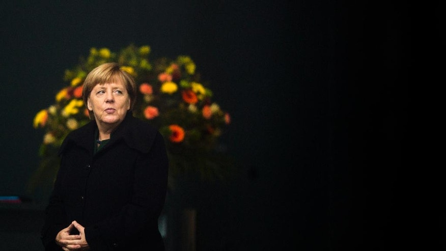 German Chancellor Angela Merkel waits in the foyer of the chancellery  for  the arrival of Panama's President Juan Carlos Varela for talks in Berlin, Tuesday, Oct. 18, 2016. (AP Photo/Markus Schreiber)