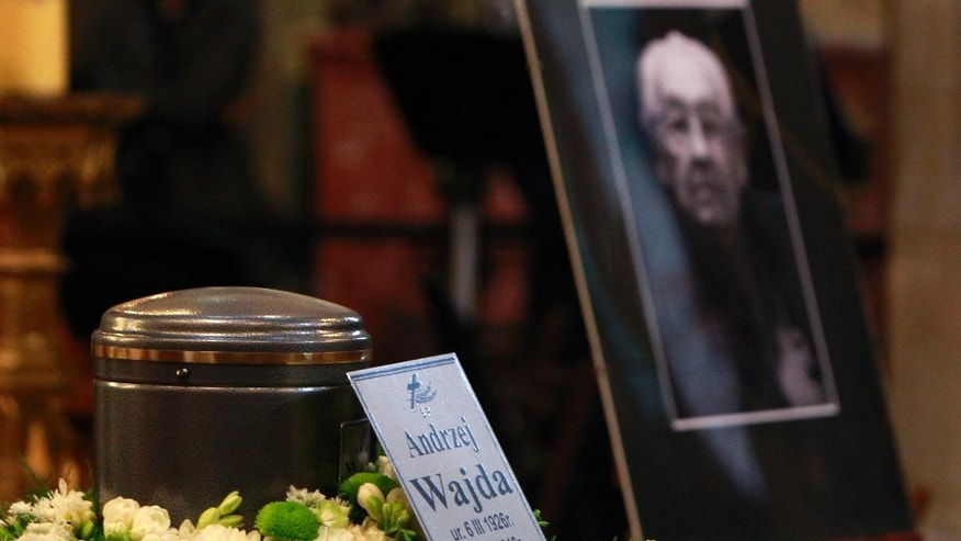 The urn with the ashes of Poland filmmaker Andrzej Wajda is set out during a farewell ceremony, in Krakow, Poland, Wednesday, Oct. 19, 2016. Wajda died in hospital on Oct. 9, at the age of 90. He will be laid to rest at Krakow's Salwator Cemetery where his mother is buried. (AP Photo/Czarek Sokolowski)