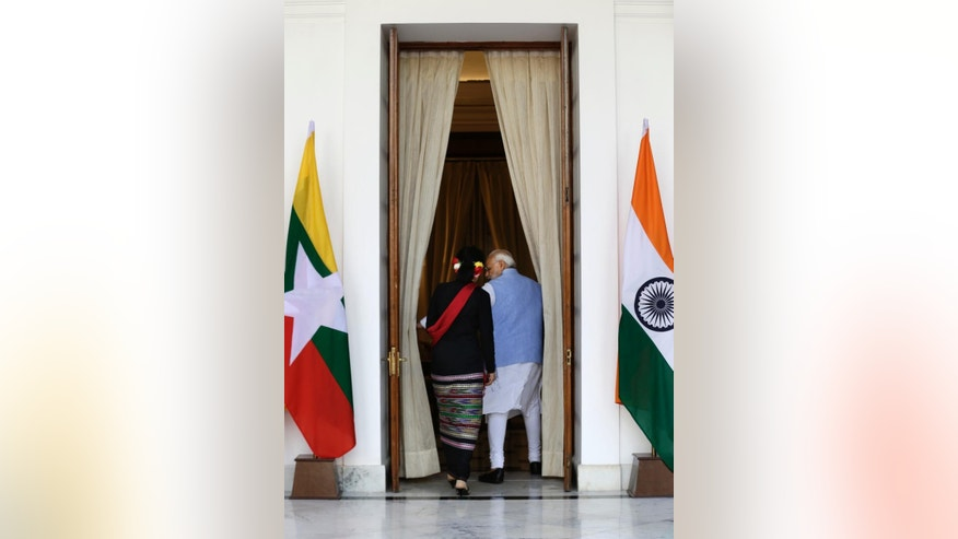 Indian Prime Minister Narendra Modi, right, walks with Myanmar's Foreign Minister Aung San Suu Kyi for a bilateral meeting in New Delhi, India, Wednesday, Oct. 19, 2016, (AP Photo/Saurabh Das)