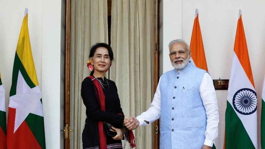 Indian Prime Minister Narendra Modi, right, shakes hand with Myanmar's Foreign Minister Aung San Suu Kyi before a bilateral meeting in New Delhi, India, Wednesday, Oct. 19, 2016, (AP Photo/Saurabh Das)