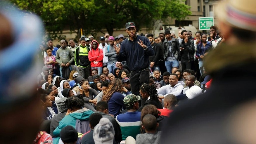 Economic Freedom Front (EFF) activist and student leader Vuyani Pambo addresses students at the University of the Witwatersrand in Johannesburg, South Africa, Wednesday, Oct. 19 2016. Protests calling for free education have sometimes turned violent and have roiled many South African universities since last month. (AP Photo/Jerome Delay)