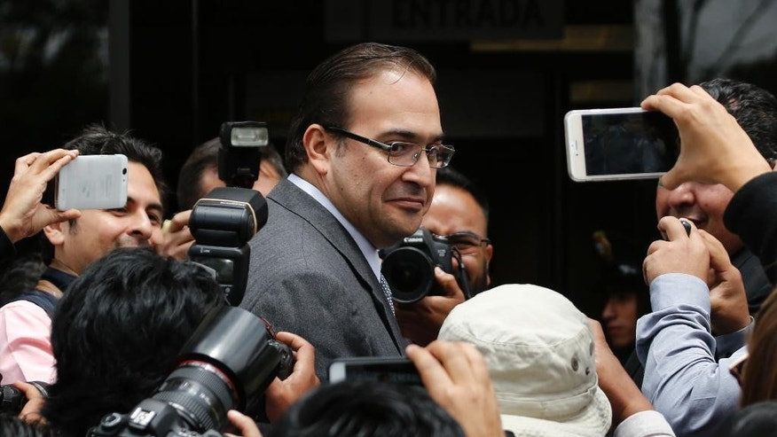 FILE - In this Aug. 5, 2016 file photo, outgoing Veracruz Gov. Javier Duarte arrives to the Attorney General's headquarters in Mexico City. A senior Mexican official says prosecutors are trying to detain the former governor on suspicion of corruption. Interior Minister Miguel Angel Osorio Chong told Radio Formula on Wednesday, Oct. 19, 2016 that officials aren't sure where Duarte is, but believe he's still in the country. Duarte stepped down as governor in mid-October, saying he wanted to confront the corruption allegations, which he denies. (AP Photo/Marco Ugarte, File)