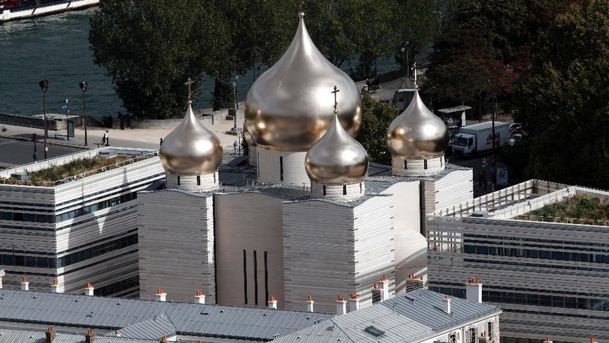 This photo taken on Sept.28, 2016 shows the he new Russian Holy Trinity orthodox cathedral in Paris. Russian President Vladimir Putin had planned to attend the inauguration ceremony at the Russian Orthodox Spiritual and Cultural Center Wednesday Oct. 19, 2016 in the heart of the French capital but postponed his visit to Paris following a spat with French leader Francois Hollande over the war in Syria. (AP Photo/Christophe Ena)