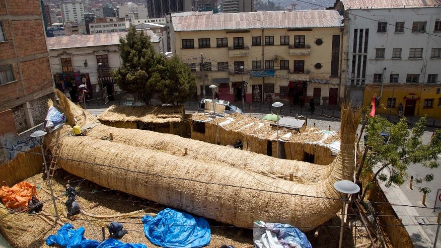 """Workers continue construction of a reed boat named the """"Viracocha III,"""" and built by Bolivian Aymara Indians, in La Paz, Bolivia, Wednesday, Oct. 19, 2016. American explorer Phil Buck is preparing to cross the Pacific Ocean from South America to Australia in the Viracocha III, a  three-masted boat that was made from several tons of dried reeds of the totora plant. The expedition seeks to prove that ancient mariners could have made such journeys across huge ocean expanses in reed ships, and that such vessels could have been a factor in human migration. (AP Photo/Juan Karita)"""