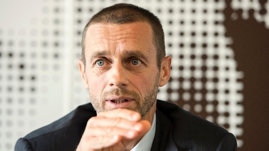 UEFA President Aleksander Ceferin  gestures during an interview with The Associated Press, at the UEFA Headquarters in Nyon, Switzerland, Thursday, Oct. 20, 2016. The Champions League final could be contested outside Europe from the first time, new UEFA President Aleksander Ceferin revealed Thursday. In an exclusive interview with The Associated Press, Ceferin said he is preparing the first open bidding process for the right to host European soccer's showpiece fixture and is open to it being staged in New York. (Jean-Christophe Bott/Keystone via AP)