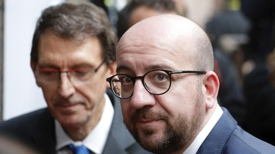 Belgian Prime Minister Charles Michel arrives for the EU summit in Brussels, Thursday, Oct. 20, 2016. British Prime Minister Theresa May will hold her first talks with European Union leaders and tell them that the U.K.'s decision to leave the bloc is irreversible. (AP Photo/Olivier Matthys)