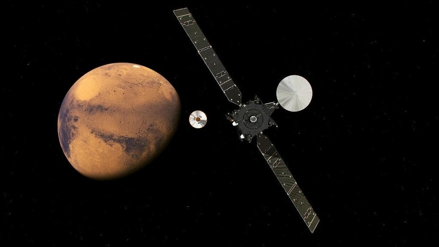 In this artist impression provided by the European Space Agency, ESA, the  ExoMars Trace Gas Orbiter, TGO, right, and its entry, descent and landing demonstrator module, Schiaparelli, center, approaching Mars. The separation was scheduled to occur on Sunday Oct. 16, about seven months after launch. Schiaparelli is set to enter the martian atmosphere on Wednesday, Oct. 19, 2016 while TGO will enter orbit around Mars. The probe will take images of Mars and conduct scientific measurements on the surface, but its main purpose is to test technology for a future European Mars rover.  Schiaparelli's mother ship will remain in orbit to analyze gases in the Martian atmosphere to help answer whether there is or was life on Mars. (ESA ATG/medialab via AP)