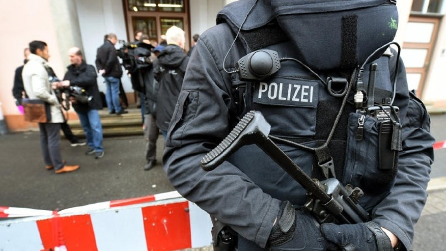 Armed police officers secure the State High Court of Lower Saxony in Celle.