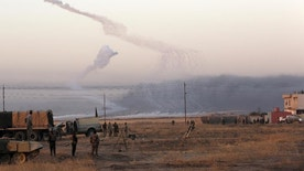 Smoke rises in nearby Mosul as Iraq's elite counterterrorism forces advance towards the city, Iraq, Thursday, Oct. 20, 2016. Iraqi special forces charged into the Mosul battle Thursday with a pre-dawn advance on a nearby town held by the Islamic State group, a key part of a multi-pronged assault on eastern approaches to the besieged city. (AP Photo/Khalid Mohammed)