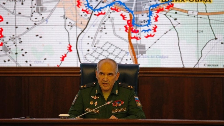 "Lt. Gen. Sergei Rudskoi of the Russian military's General Staff speaks, in front of a map of the Aleppo area in Syria, at a briefing at the Russian Defense Ministry's headquarters in Moscow, Russia, Wednesday, Oct. 19, 2016. The Russian military says that Russian and Syrian warplanes are staying away from Aleppo a day before a temporary pause in the military push declared by Moscow. Lt. Gen. Sergei Rudskoi said the ""humanitarian pause"" in Aleppo will last from 8 a.m. to 7 p.m. Thursday, three hours longer than the Russian military initially announced. (AP Photo/Alexander Zemlianichenko)"